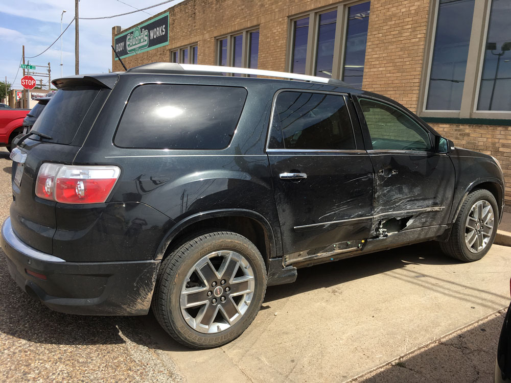 Edwards Bodyworks Black SUV repair before
